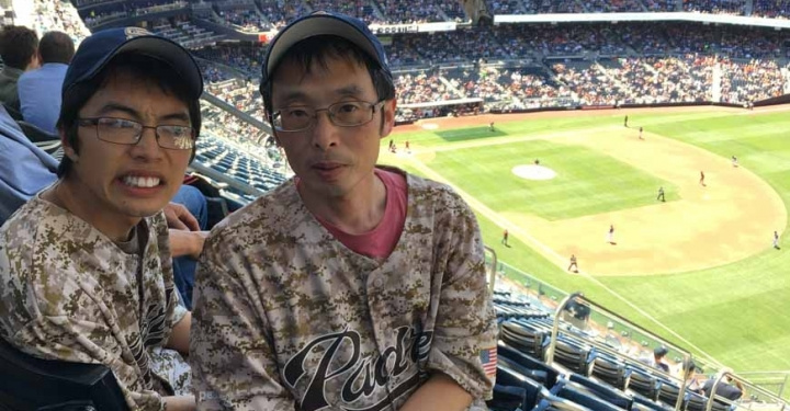 Fumitoshi Irie, Ph.D., and son at a recent baseball game