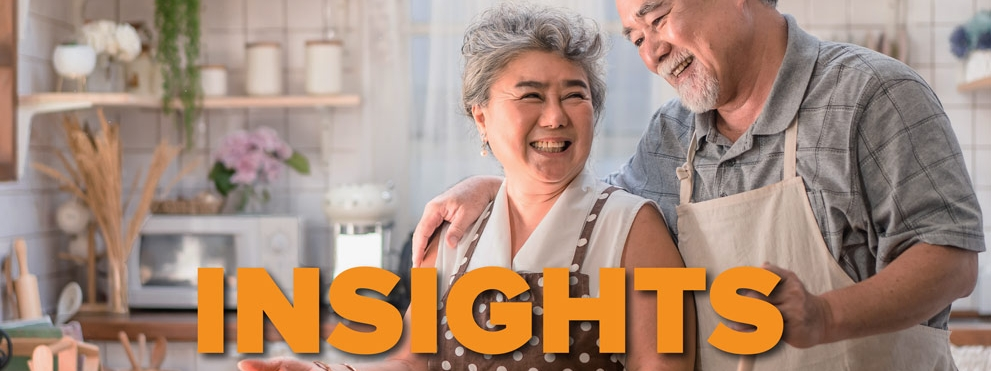 insights diet graphic: happy older couple cooking together in kitchen