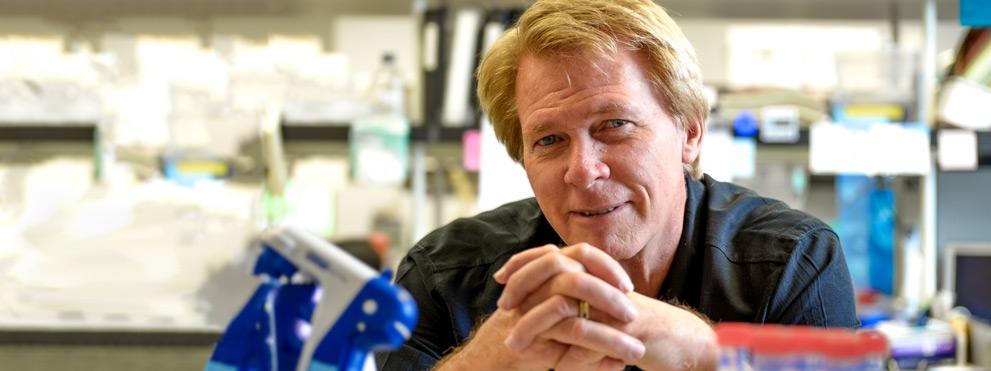 Hudson Freeze, Ph.D., profile photo in lab