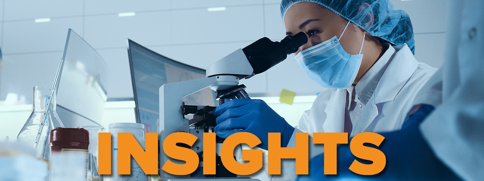 Masked woman scientist in lab working at microscope, insights text overlay