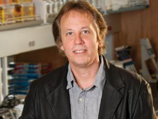 Jamey Marth, Ph.D. standing in the lab